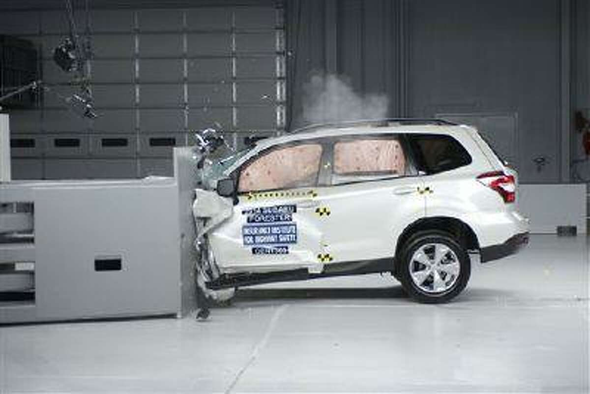 """A 2014 Subaru Forester during a small overlap frontal crash test. Subaru's 2014 Forester is one of only two of 13 small SUVs that are getting passing grades in front-end crash tests done by the Insurance Institute for Highway Safety. Popular models such as the Honda CR-V, Ford Escape and Jeep Wrangler received only """"marginal"""" or """"poor"""" ratings from the Insurance Institute for Highway Safety. (AP Photo/Insurance Institute for Highway Safety)"""