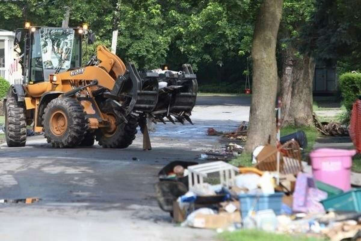 Dispatch Photo by John Haeger// Crews continue to work on flood clean-up in the city of Oneida.