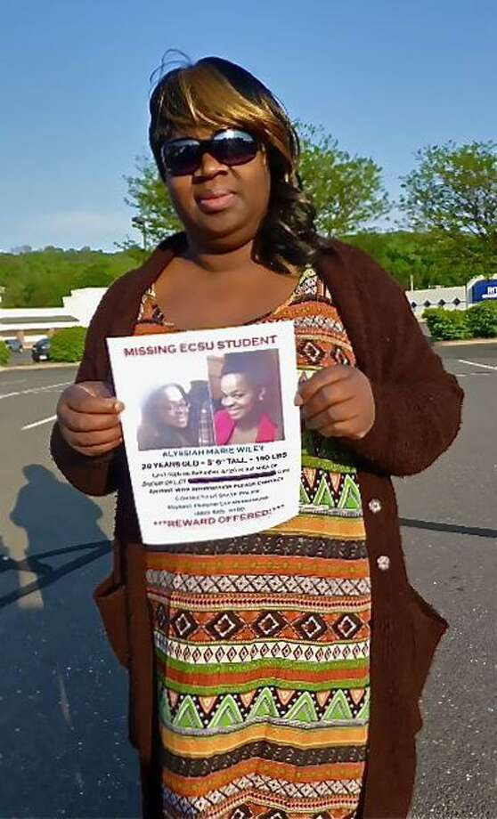 Corinna Martin, the mother of missing ECSU student Alyssiah Marie Wiley, holds her daughter's missing person poster Wednesday. Patricia Villers/Register file photo