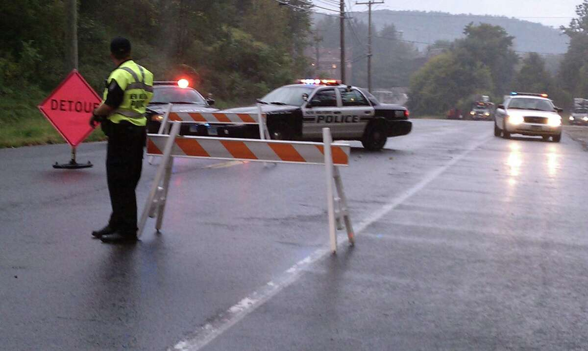 Police blocked off a section of northern Route 7, about 2 miles from the center of New Milford, from about 2 a.m. Tuesday night into the late morning hours on Wednesday, while officials continued their investigation of a shooting at the Rocky River Motel on Tuesday night, Sept. 25. Photograph by Laurie Gaboardi
