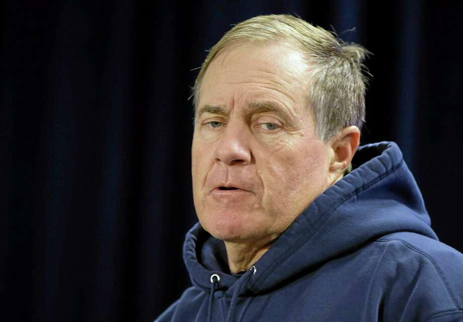 Patriots head coach Bill Belichick responds to a reporter's question during a media availability session this week. Photo: Stephan Savoia — The Associated Press   / AP