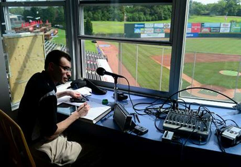 Jonathan Newton - Washington PostJason Benetti, the voice of the Syracuse Chiefs, prepares his notes prior to a game against the Charlotte Knights last month in Fort Hill, S.C. / The Washington Post
