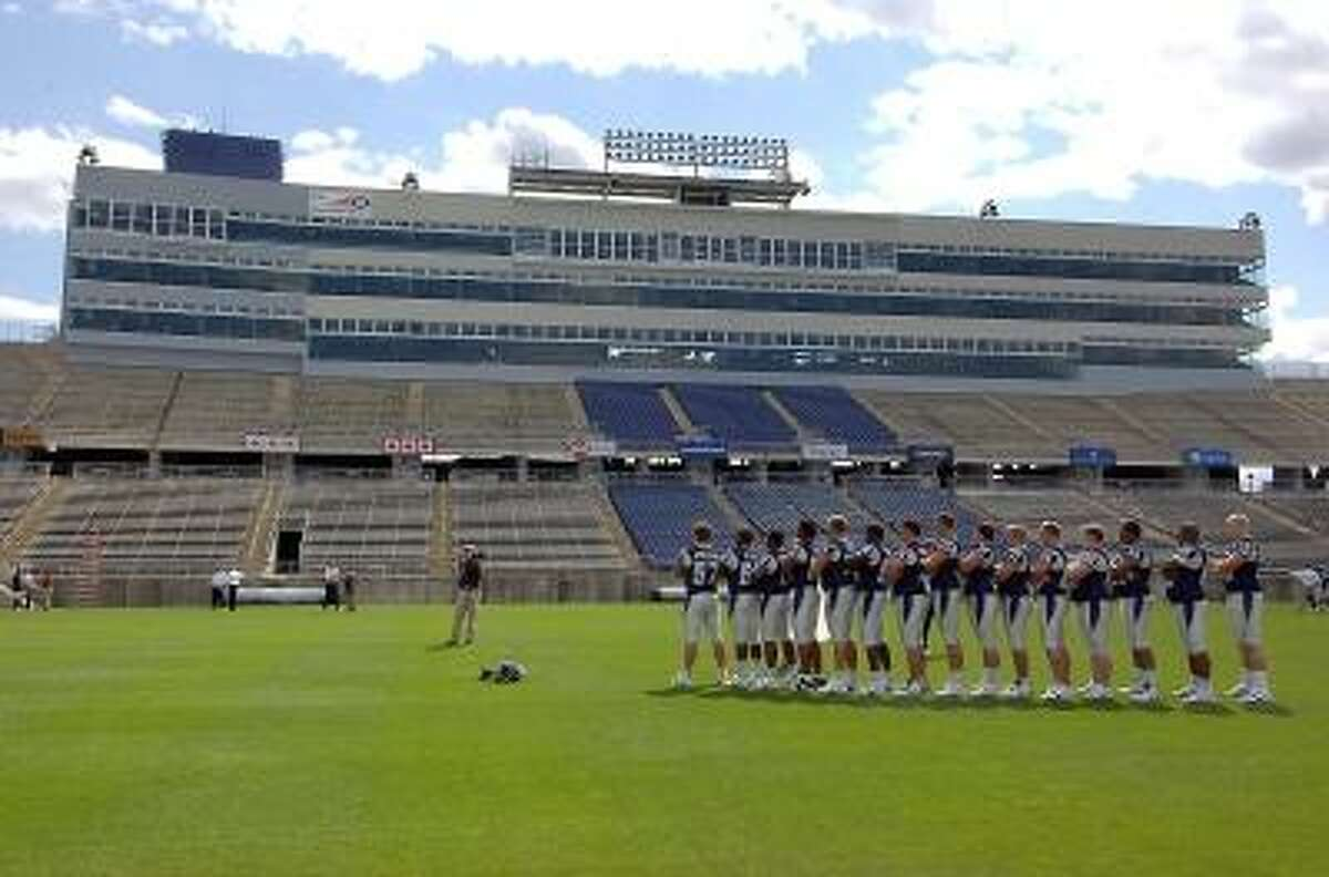Connecticut football players line up for a photo on media day at Rentschler Field in 2006. Photo by Jessica Hill/Associated Press