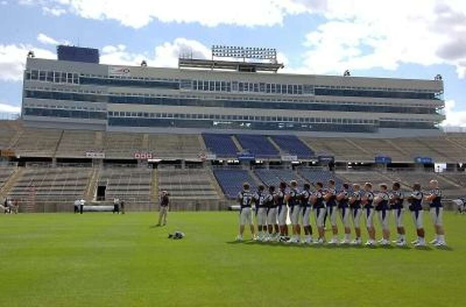Connecticut football players line up for a photo on media day at Rentschler Field in 2006. Photo by Jessica Hill/Associated Press Photo: AP / 2006 AP