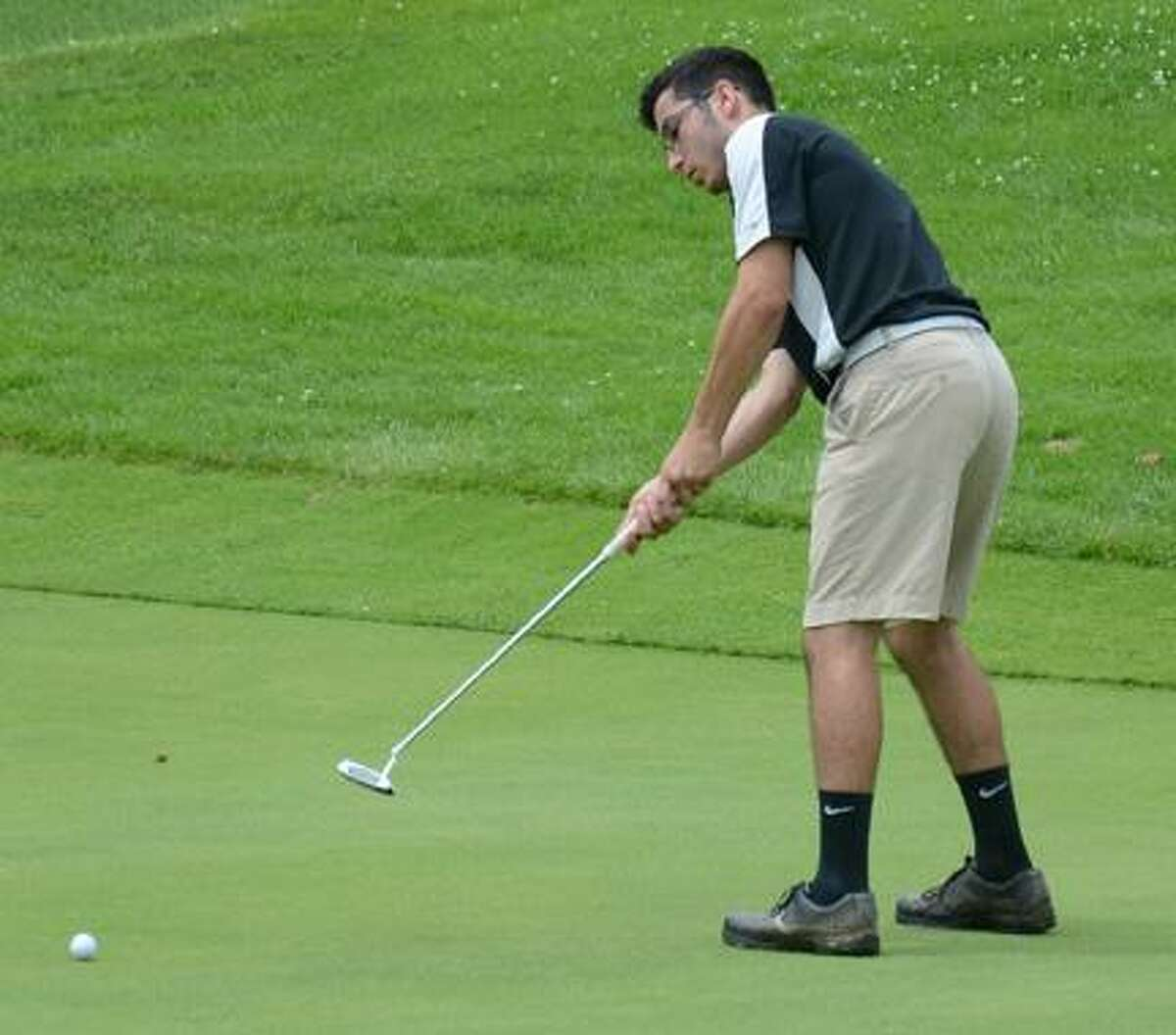 JESSI PIERCE - ONEIDA DAILY DISPATCH Camden's Evan Kessler putts during the Mohawk Valley Junior Golf Tour event at Valley View on Monday.