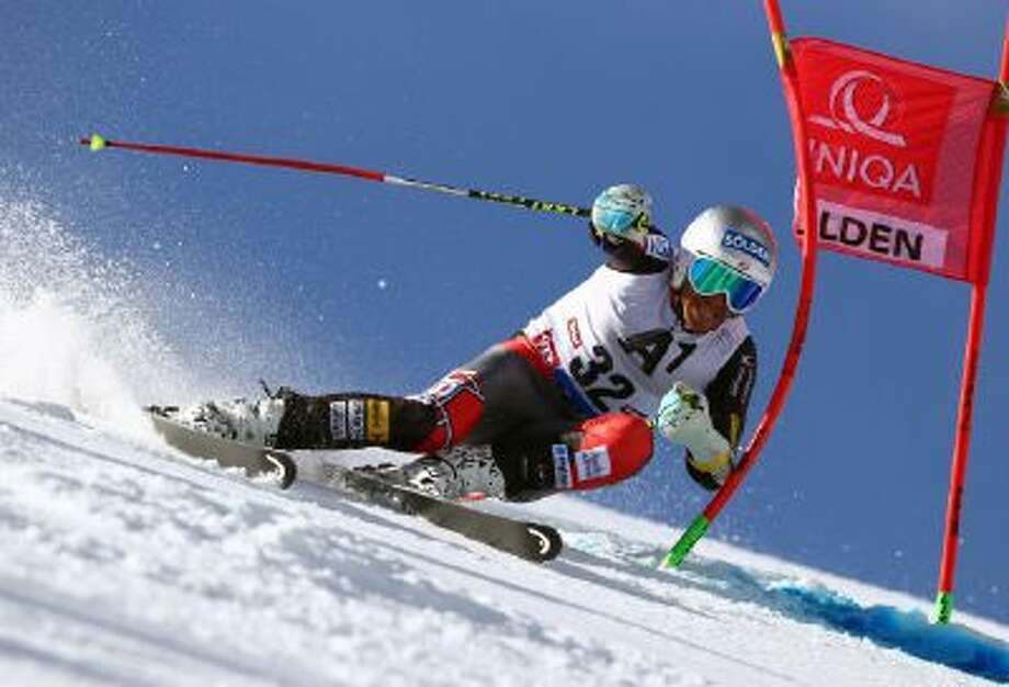 Bode Miller, of the United States, speeds down the course during the first run of an alpine ski, men's World Cup giant slalom, in Soelden, Austria, Sunday, Oct. 27, 2013.