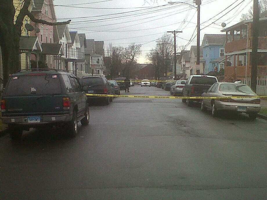 Crime scene tape is seen in the Fair Haven section of New Haven as police investigate the shooting death of Joseph Zargo of West Haven in December 2011. Photo by William Kaempffer/Register file photo