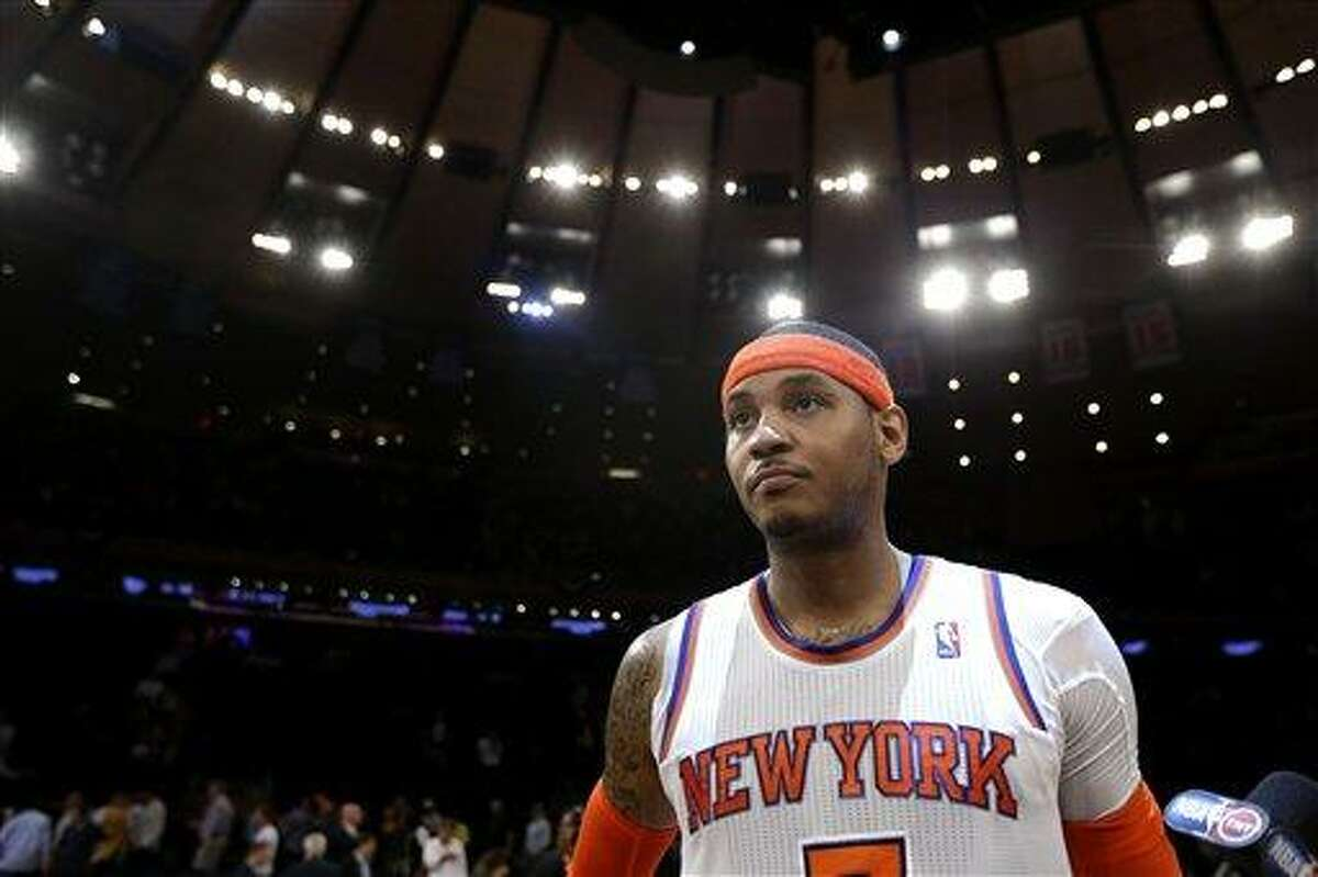 New York Knicks' Carmelo Anthony walks off the court at the end of Game 5 of an NBA basketball playoff series in the Eastern Conference semifinals game against the Indiana Pacers at Madison Square Garden in New York, Thursday, May 16, 2013. The Knicks won 85-75. (AP Photo/Julio Cortez)
