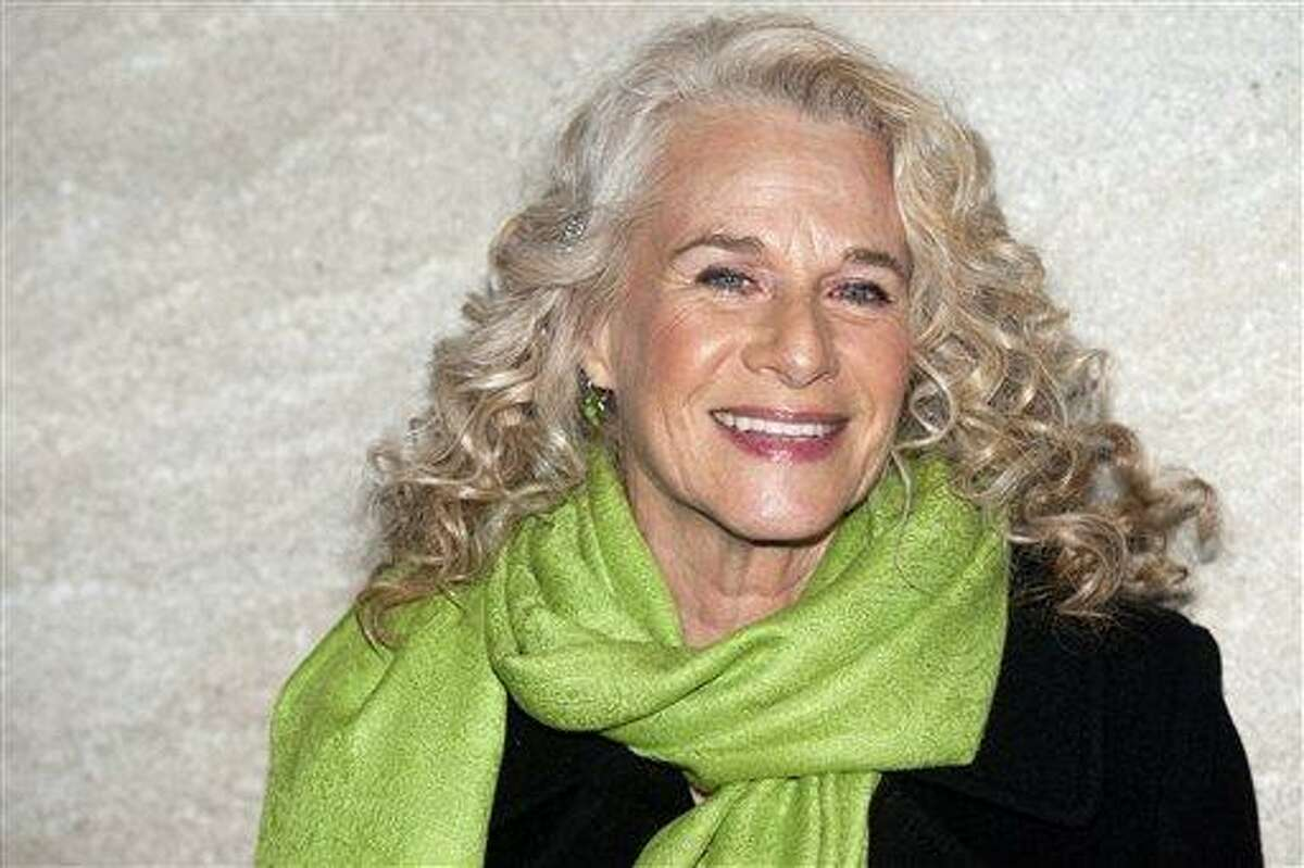 """FILE - In this Nov. 30, 2011 file photo, musician Carole King attends the Rockefeller Center Christmas tree lighting in New York. Producers announced Friday, March 15, 2013 that they plan to take """"Beautiful: The Carole King Musical"""" to Broadway by spring 2014. (AP Photo/Charles Sykes, File)"""