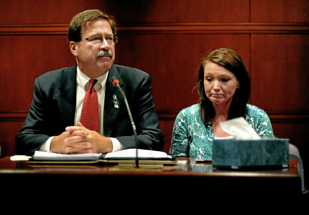 Bill Sherlach, left, husband of Sandy Hook Elementary School shooting victim Mary Sherlach, and Nicole Hockley, mother of victim Dylan Hockley, speak before the Task Force on Victim Privacy and the Publics Right To Know, Wednesday, Oct. 30, 2013, in Hartford, Conn. Sherlach and Hockley told the panel they don't want the 911 tapes from that day released to the public. The Freedom of Information Commission has ordered the release of the 911 recordings, but a prosecutor has said the ruling will be appealed. (AP Photo/Jessica Hill)