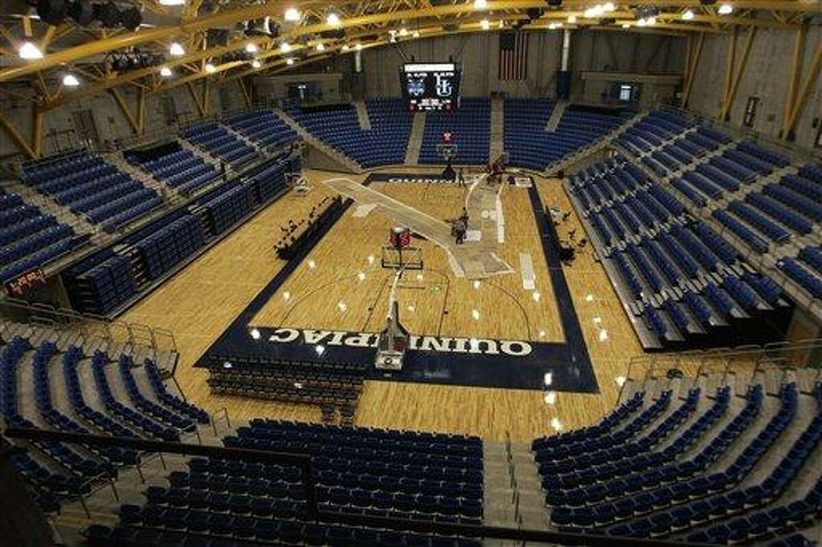 The new 3,570-seat basketball arena at Quinnipiac University's TD Banknorth Sports Center is almost ready for opening day in Hamden, Conn., as seen Thursday, Jan. 25, 2007. The sports center, which also houses a 3,286-seat hockey arena, is to open Saturday. (AP Photo/Bob Child)