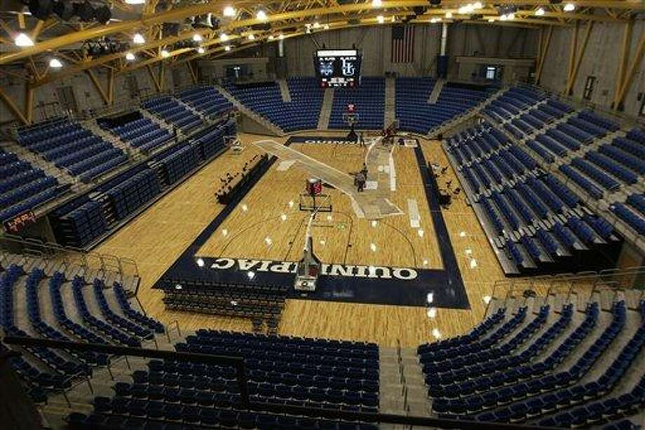 The new 3,570-seat basketball arena at Quinnipiac University's TD Banknorth Sports Center is almost ready for opening day in Hamden, Conn., as seen Thursday, Jan. 25, 2007. The sports center, which also houses a 3,286-seat hockey arena, is to open Saturday.  (AP Photo/Bob Child) Photo: ASSOCIATED PRESS / AP2007