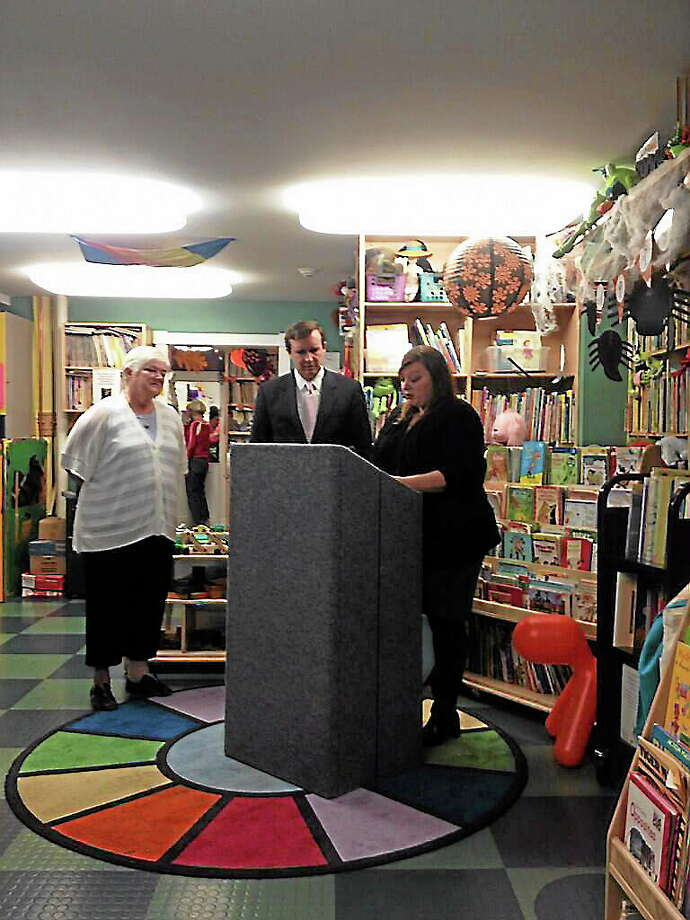 Nanci Dower, owner of Sunny Side Up Early Care Learning Center, US Senator Chris Murphy and outreach coordinator for U.S. Rep.  Rosa DeLauro, Allison Dodge, delivering announcement of bill to double flexible spending savings for employees for child care. Photo: Journal Register Co.
