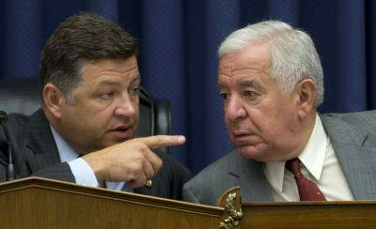 House Transportation and Infrastructure Full Committee Chairman Rep. Bill Shuster, R-Pa., left, talks to the committee's ranking Democrat Rep. Nick Rahall, D-W.Va. on Capitol Hill in Washington, Thursday, May 16, 2013, during the committee's markup to consider legislation on the Keystone XL pipeline project and other measures. (AP Photo/Carolyn Kaster)