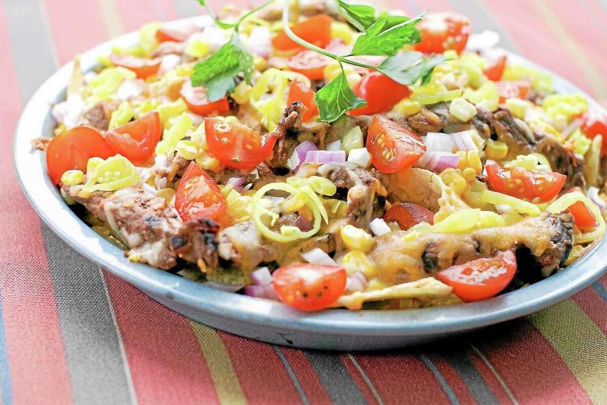 AP Photo/Matthew MeadCorn and steak grilled nachos are shown.