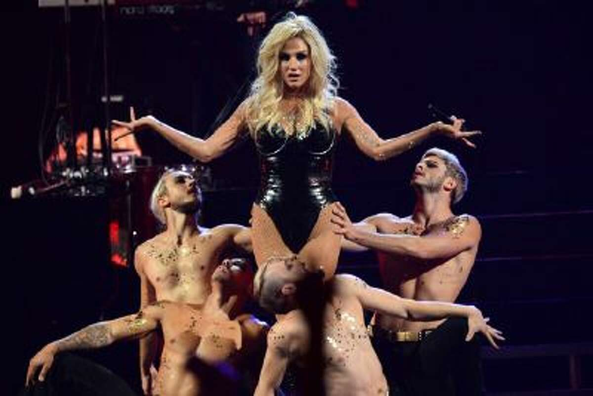 In this Sep. 22 2013 file photo, Ke$ha performs at the IHeartRadio Music Festival, in Las Vegas. Authorities in Muslim-majority Malaysia have banned a planned concert by U.S. pop singer Ke$ha after deciding it would hurt cultural and religious sensitivities.