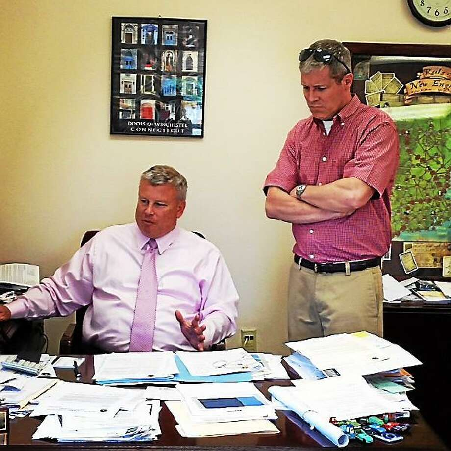 New Winsted Public Works Director Neil Amwake (standing) with Town Manager Dale Martin. Mercy Quaye - Register Citizen
