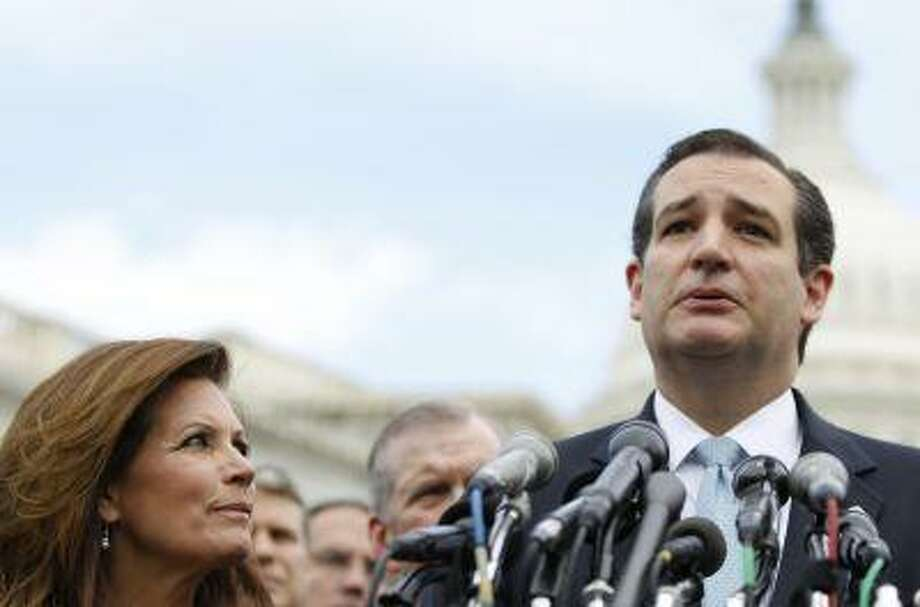 Sen. Ted Cruz, R-Texas, accompanied by Rep. Michele Bachmann, R-Minn., chair of the Tea Party Caucus, speaks during a news conference with Tea Party leaders Thursday, May 16, 2013, on Capitol Hill in Washington. Photo: ASSOCIATED PRESS / AP2013