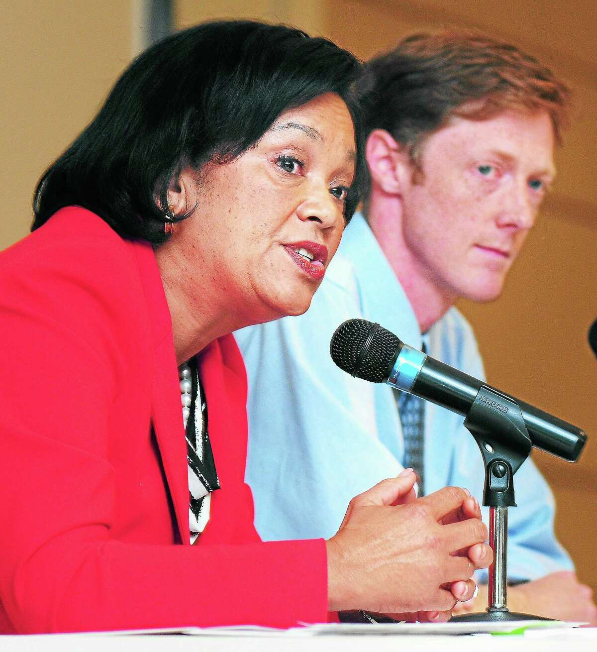 (Arnold Gold — New Haven Register) New Haven mayoral candidate Toni Harp (left) answers a question during a debate with Justin Elicker (right) at Gateway Community College in New Haven on 10/22/2013.