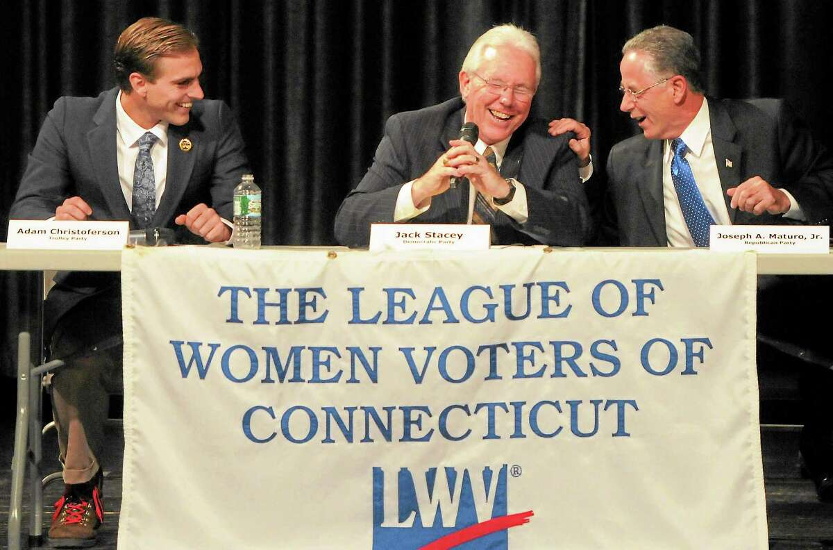 East Haven mayoral candidates Adam Cristoferson of the Trolley Party, Democrat Jack Stacey and incumbent Republican Joseph Maturo share a laugh at a debate Friday night.