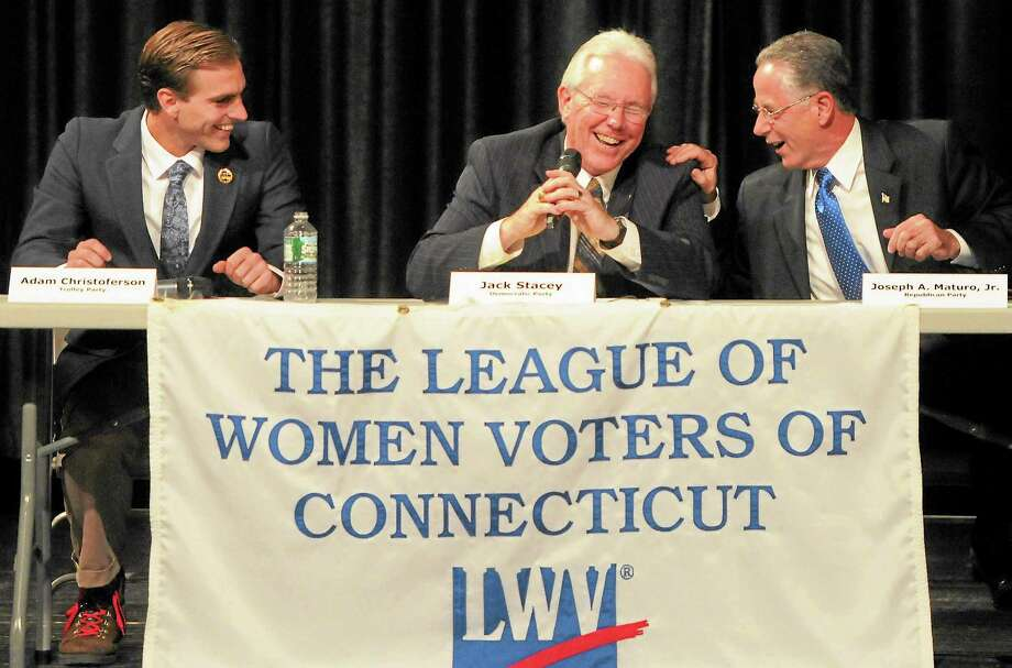 East Haven mayoral candidates Adam Cristoferson of the Trolley Party, Democrat Jack Stacey and incumbent Republican Joseph Maturo share a laugh at a debate Friday night. Photo: Peter Hvizdak — New Haven Register            / ©Peter Hvizdak /  New Haven Register