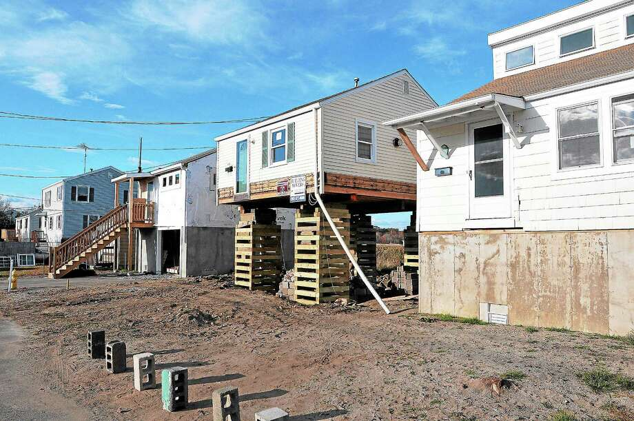 Homes along Cooper Avenue in Milford, damaged during Superstorm Sandy, are seen last week. Photo: Peter Casolino — New Haven Register
