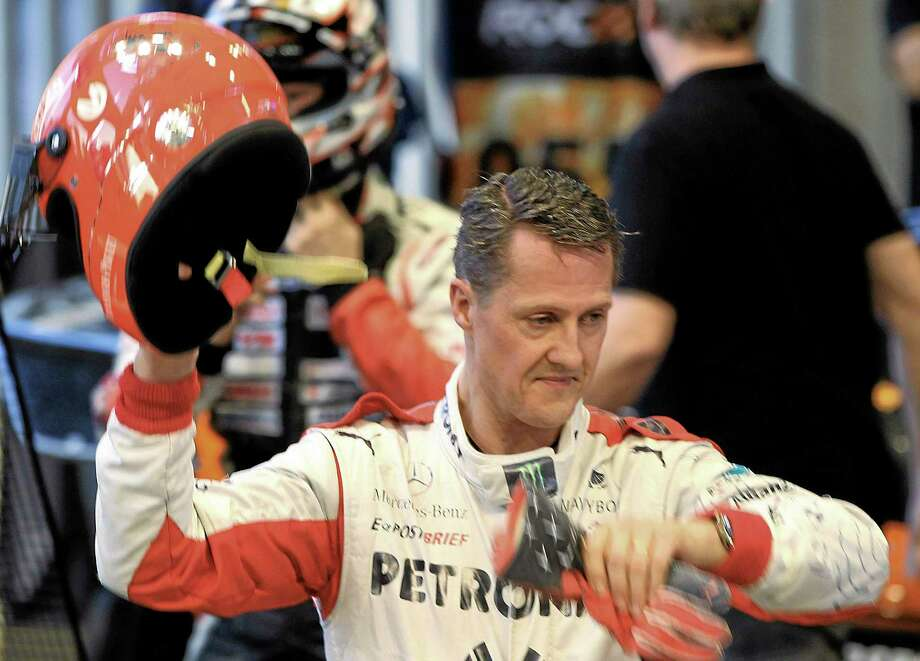 Michael Schumacher, here after a test drive prior to the Race Of Champions in Bangkok, Thailand, has had two surgeries since suffering a life-threatening head injury in a ski accident Sunday in Meribel, France. Photo: Apichart Weerawong — The Associated Press   / AP