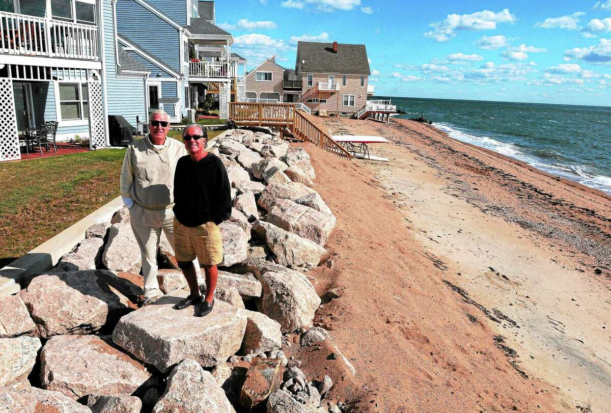 Patric Marchitto and Douglas P. MacDonald, president and vice-president of Victoria Beach Condominiums on Cosey Beach Avenue in East Haven, stand on part of a 250-foot revetment that would protect some of the condominiums from a storm.