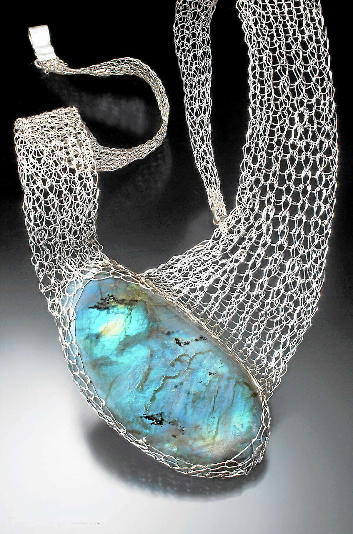 Marla Rudnick knits and weaves jewelry in silver and gold.
