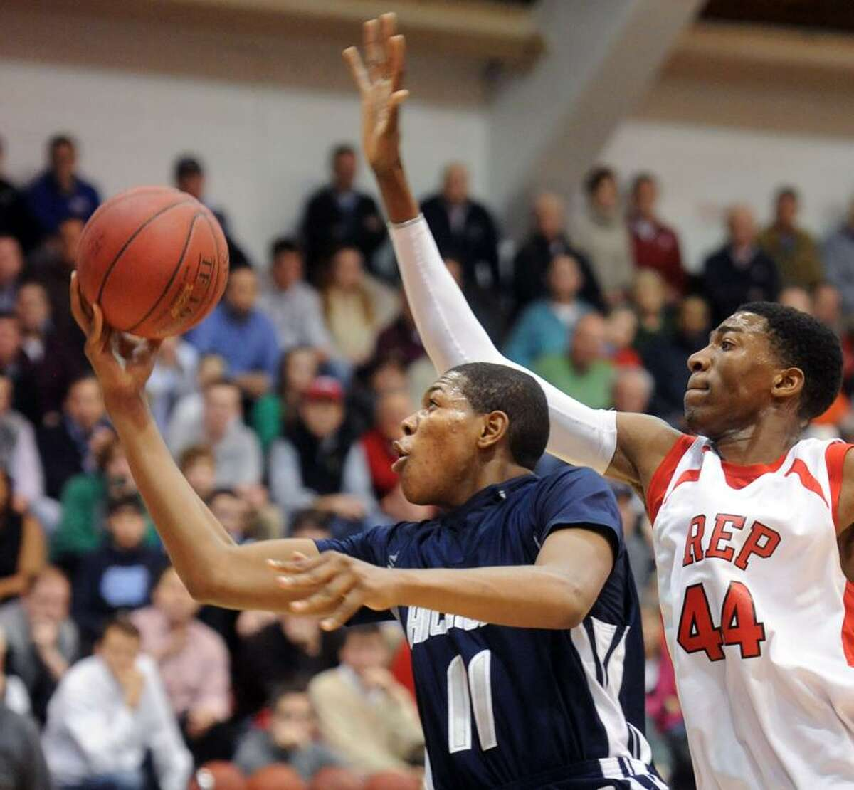 Hillhouse at Fairfield Prep, boys basketball. HH's Chaise Daniels, FP's Pascal Chukwu. Mara Lavitt/New Haven Register1/15/13