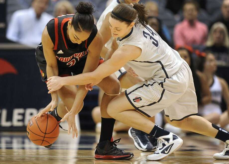 Connecticut's Kelly Faris, right, pressures Louisville's Bria Smith, left, during the first half of an NCAA college basketball game in Hartford, Conn., Tuesday, Jan. 15, 2013. (AP Photo/Jessica Hill) Photo: AP / FR125654 AP
