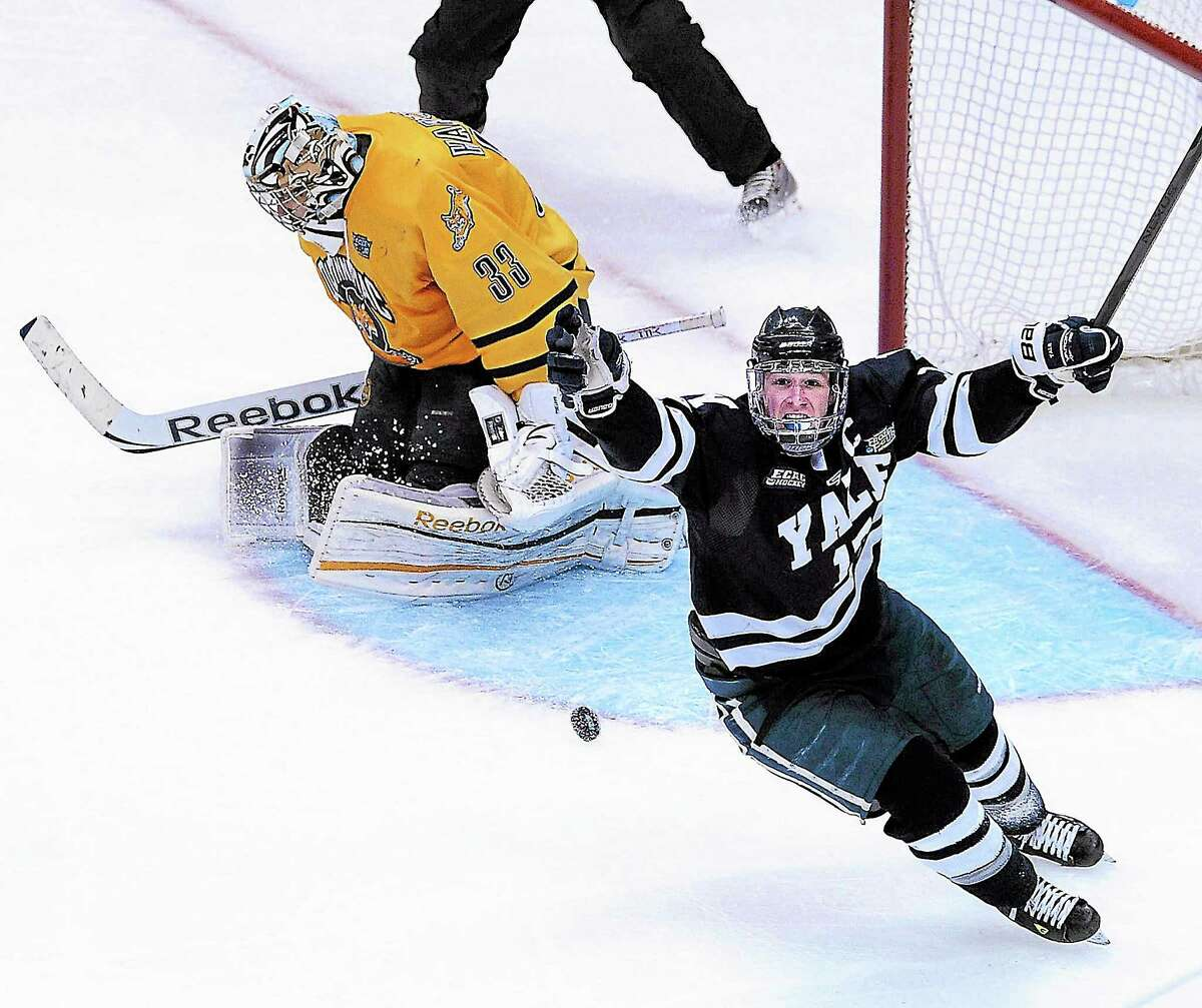 Yale's Andrew Miller celebrates his third-period goal during the Bulldogs' win over Quinnipiac for the NCAA Division I men's hockey national title at the Frozen Four in Pittsburgh on April 13.