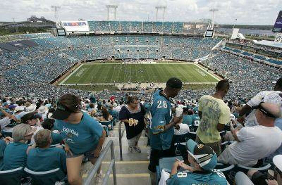 FILE -- This is a Sept. 20, 2009, file photo showing fans in Jacksonville Municipal Stadium stadium during an NFL football game between Arizona Cardinals and the Jacksonville Jaguars, in Jacksonville, Fla. So far, only Jacksonville has had its home opener blacked out last weekend. The Jaguars were so far from selling out that they didn't even bother requesting an extension.