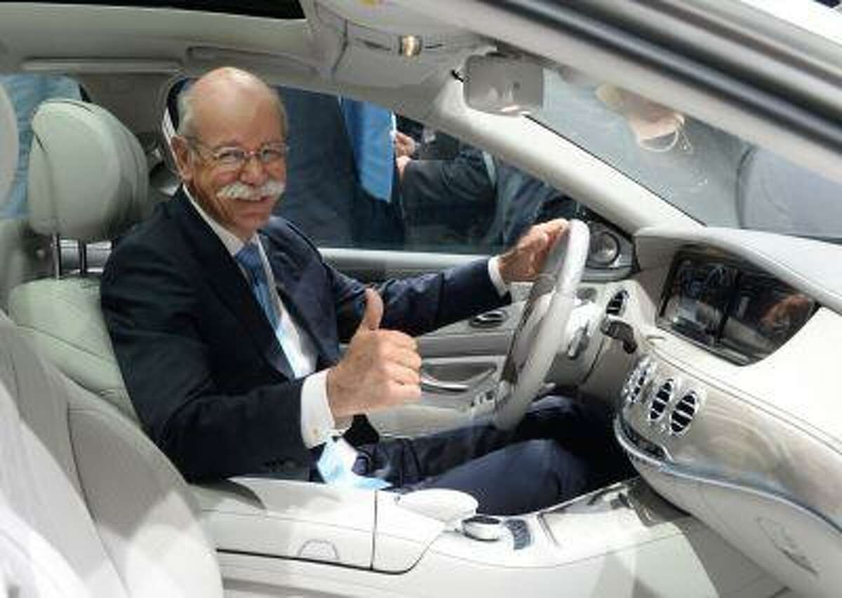 CEO of Daimler Dieter Zetsche sits in the new S-Class Mercedes presented in Hamburg, Germany, Wednesday, May 15, 2013. The new Mercedes is supposed to have lower fuel consumption and high security standards due to driving assistance.. (AP Photo/dpa/Marcus Brandt)