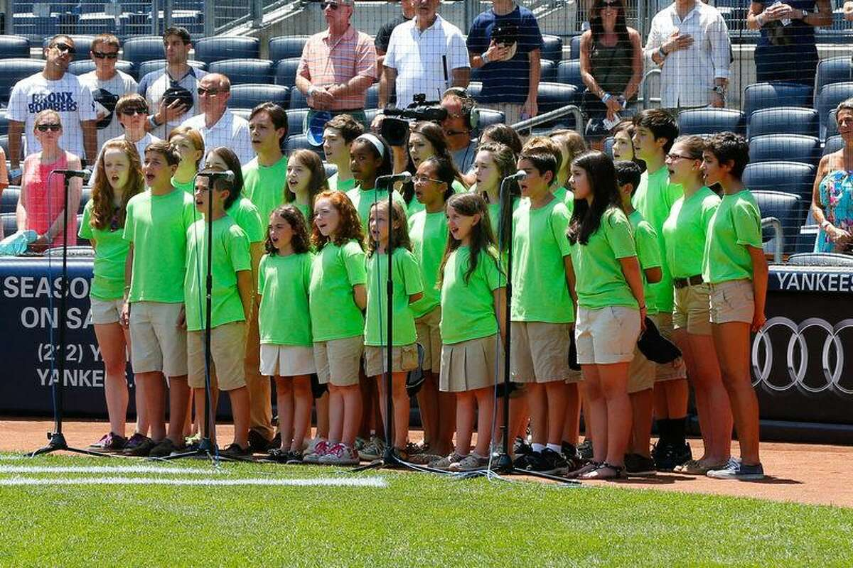 The Newtown youth choir sings the National Anthem before the game between the New York Yankees and the Baltimore Orioles at Yankee Stadium. (Anthony Gruppuso-USA TODAY Sports)