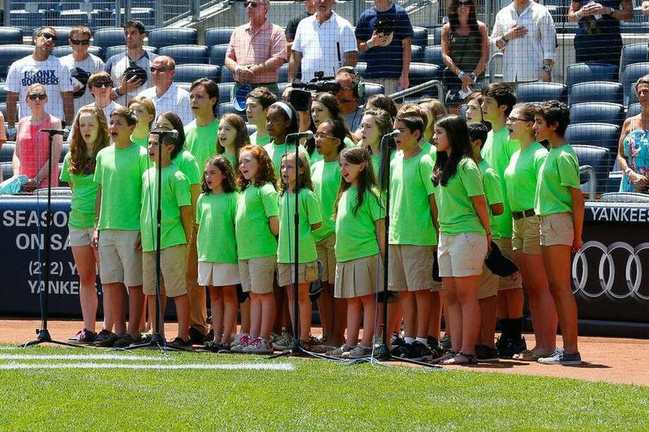 The Newtown youth choir sings the National Anthem before the game between the New York Yankees and the Baltimore Orioles at Yankee Stadium. (Anthony Gruppuso-USA TODAY Sports) Photo: USA TODAY Sports / Anthony Gruppuso