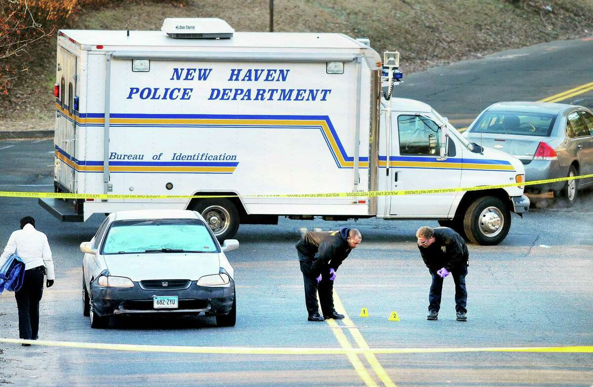 New Haven Police investigate the scene of a fatal shooting on Hemingway Street near the corner of Russell Street in New Haven early Saturday morning.
