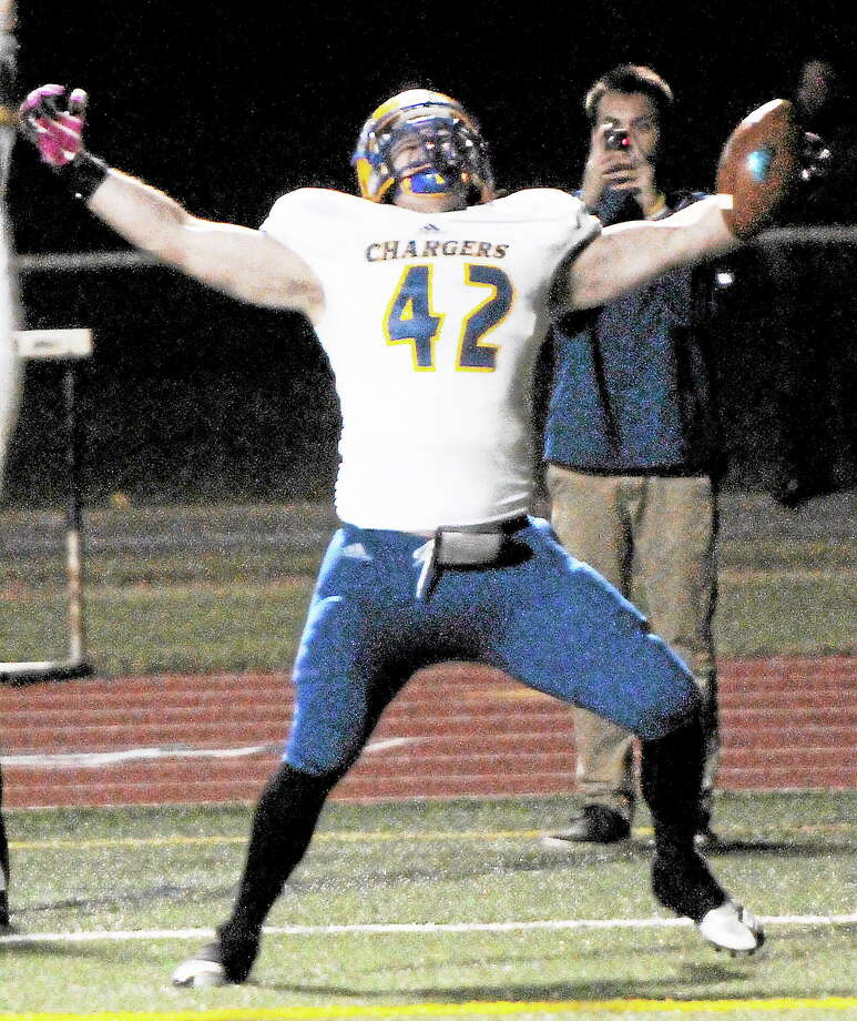 New Haven's Brandon Ruberti of Madison celebrates his first collegiate touchdown during the first half of the Chargers' 40-21 win over Southern Connecticut State Friday night at Jess Dow Field in New Haven. Photo: Peter Hvizdak — Register   / ©Peter Hvizdak /  New Haven Register