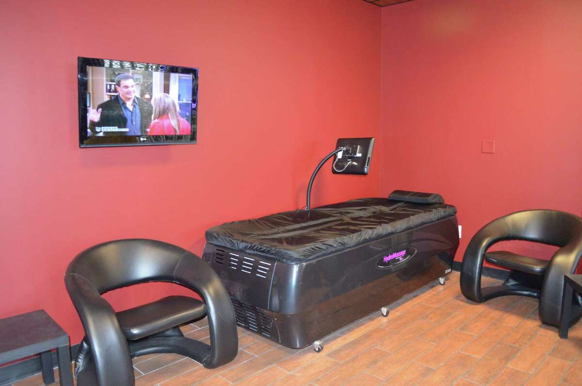 Staff Photo by RACHEL MURPHY -- One of the two new water massage beds at Planet Fitness.