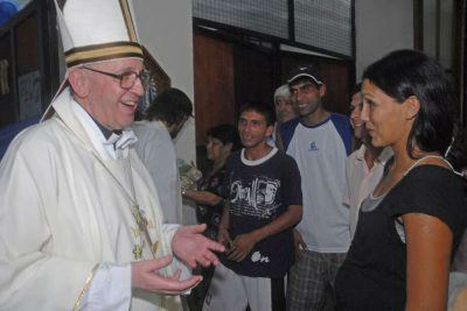 Argentina's cardinal Jorge Bergoglio, left, talks to a woman during a March 2008 mass for youth trying to overcome drug addictions in Buenos Aires, Argentina. Bergoglio, who chose the name of Pope Francis, became the 266th pontiff of the Roman Catholic Church on March 13. Photo: ASSOCIATED PRESS / AP2008