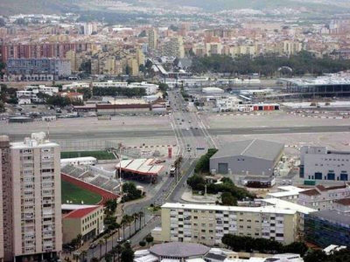 At Gibraltar Airport in Gibraltar, a major highway cuts THROUGH the airport runway. This airport is on the Airfarewatchdog.com list of Top 10 Scary Airports for 2013.