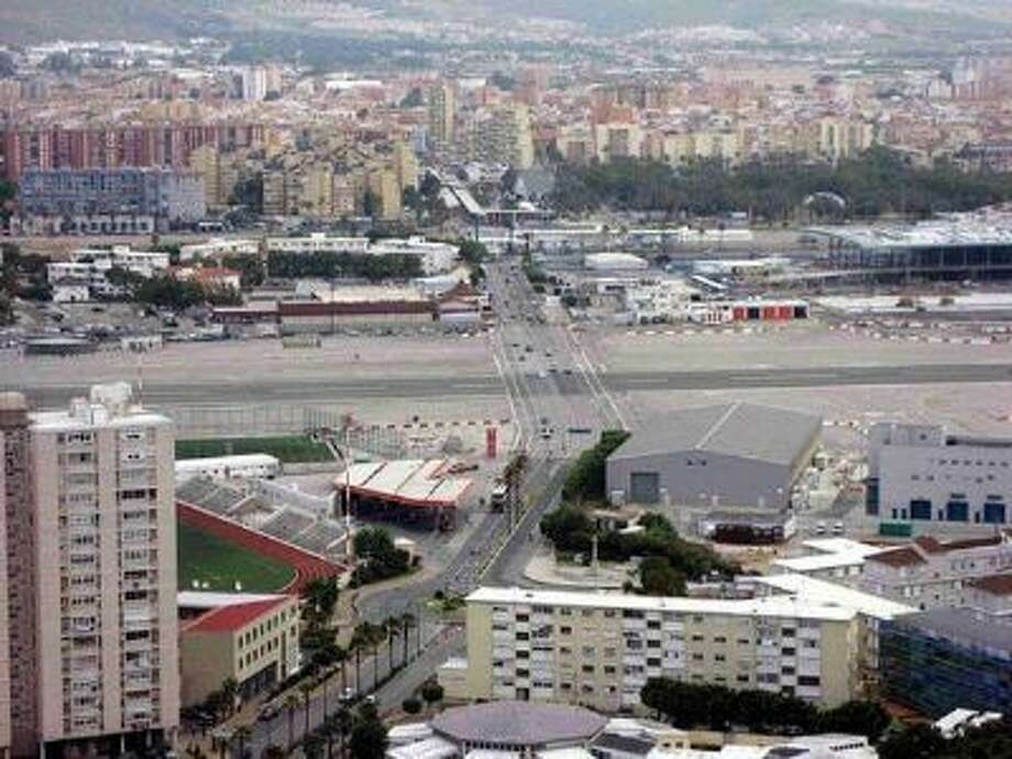 At Gibraltar Airport in Gibraltar, a major highway cuts THROUGH the airport runway. This airport is on the Airfarewatchdog.com list of Top 10 Scary Airports for 2013. Photo: Flickr Member D-Stanley / rachael.prescott@smartertravelme