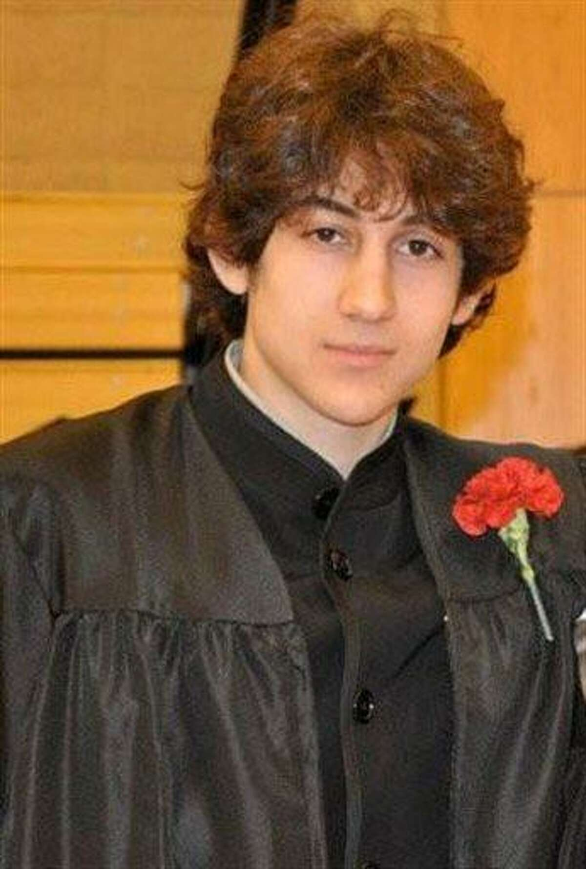 In this undated photo, Dzhokhar A. Tsarnaev poses for a photo after graduating from Cambridge Rindge and Latin High School. (AP Photo/Robin Young)