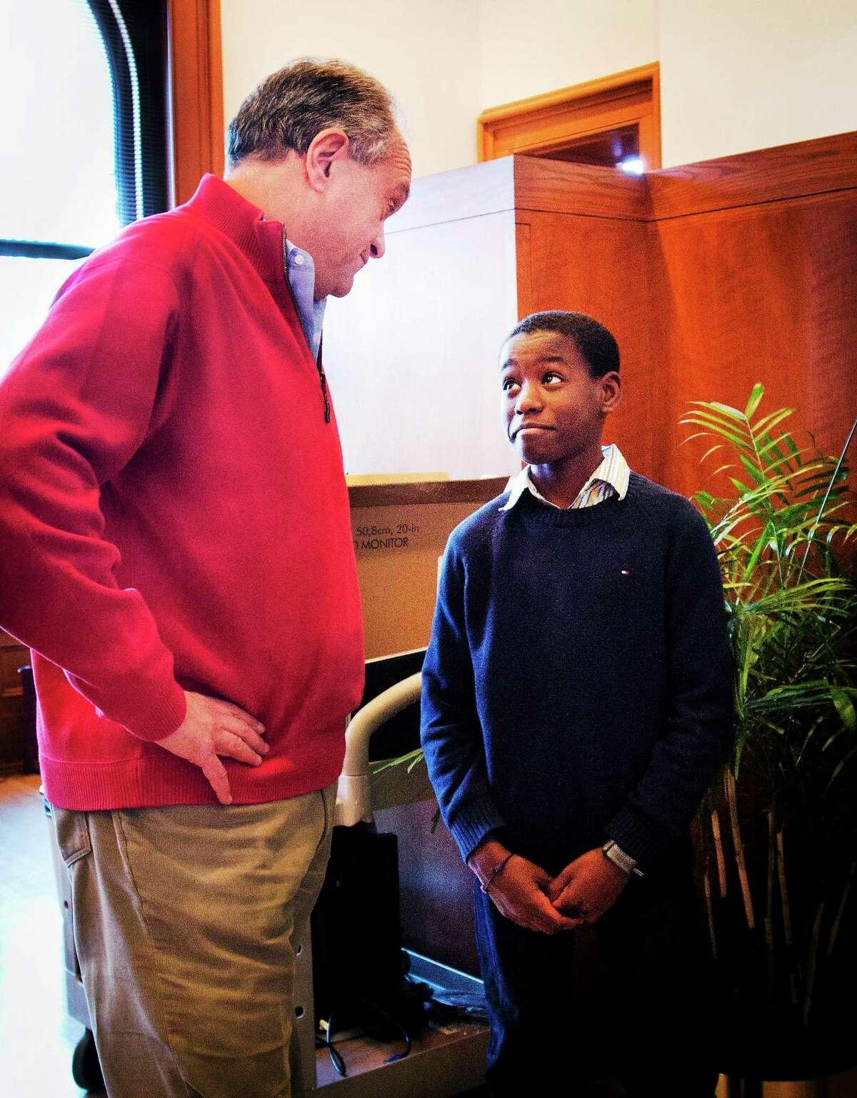 Mayor John DeStefano Jr., left, jokes with Caleb Bolden, 10, at City Hall Tuesday. Caleb is the son of Corporation Council Victor Bolden.
