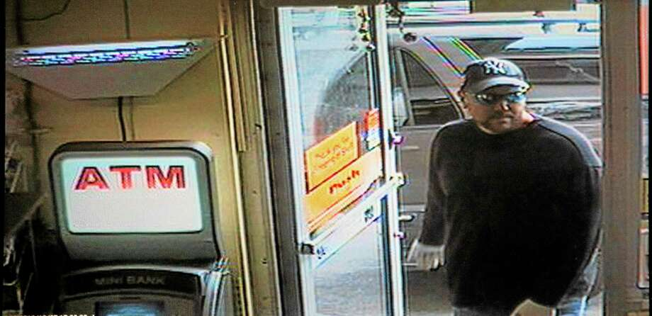 Surveillance footage shows a suspect entering the Shell Food Mart on Willow Street in New Haven Friday afternoon. Photo: Rich Scinto — New Haven Register