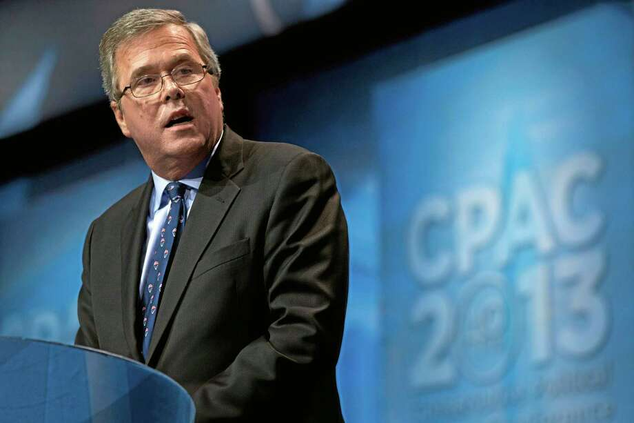 "FILE - In this March 15, 2013 file photo, former Florida Gov. Jeb Bush speaks during the Ronald Reagan Dinner at the 40th annual Conservative Political Action Conference in National Harbor, Md. Weighing in while hosting an education conference in Boston, the potential 2016 presidential candidate argued that congressional Republicans represent ""the mirror opposite"" of the successes of GOP governors outside the capital. (AP Photo/Jacquelyn Martin, File) Photo: AP / AP"