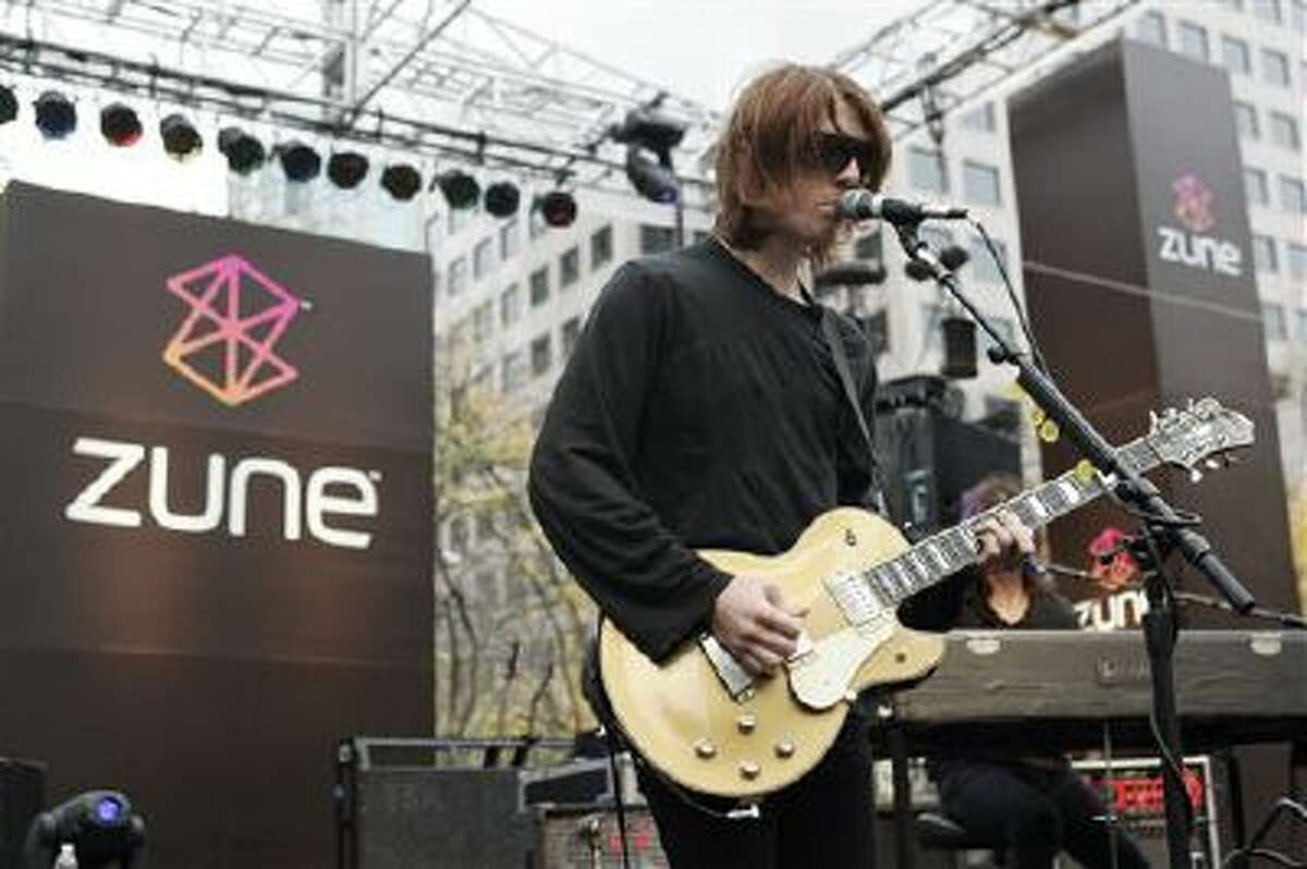 In this Nov. 13, 2006 file photo, Benjamin Curtis with the band Secret Machines performs at a launch party for Microsoft's new music player Zune at Westlake Park in downtown Seattle. Curtis, guitarist and co-founder of the popular indie-rock band School of Seven Bells, has died on Dec. 29, 2013, of cancer. He was 35.