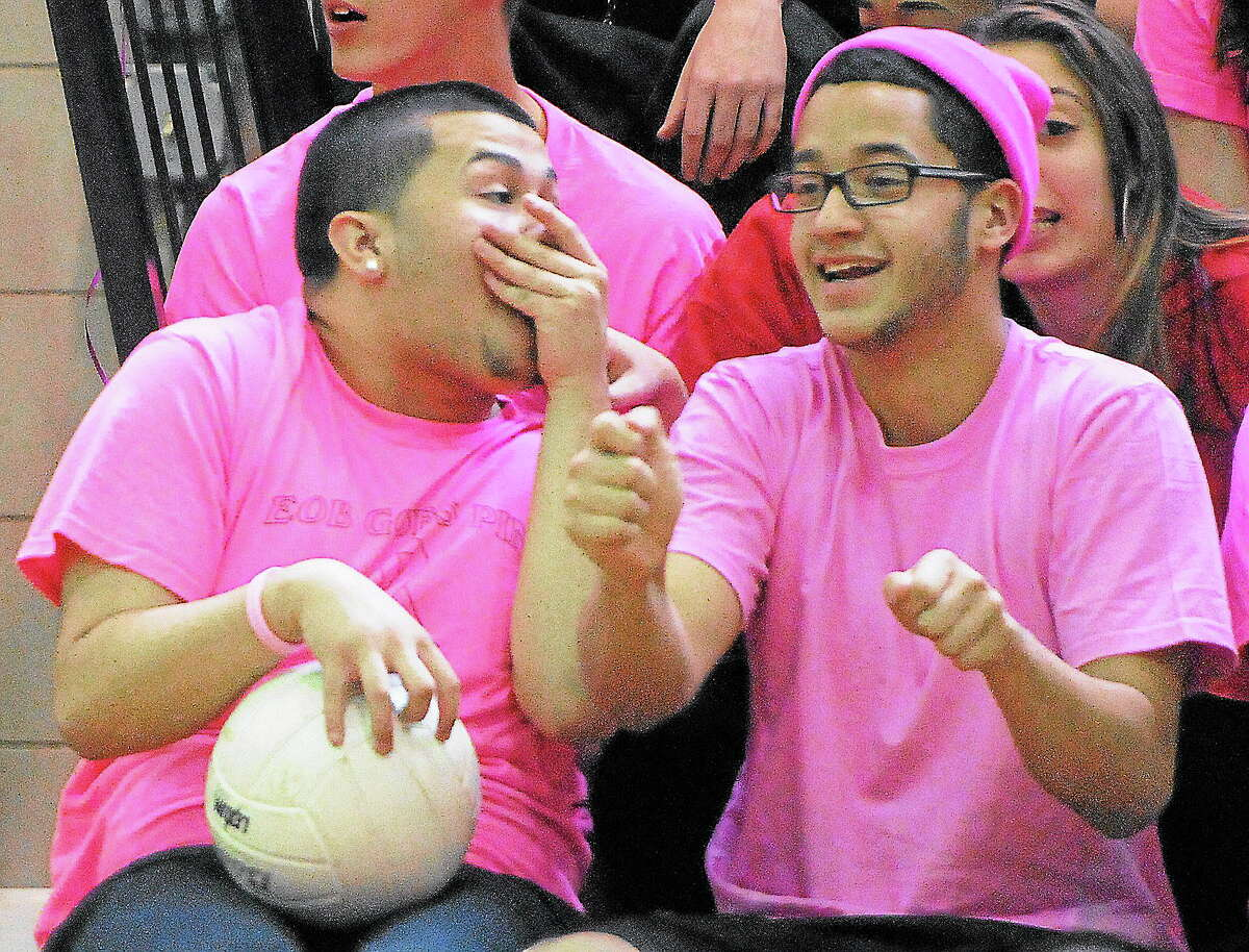 Emmett O'Brien Technical High School students Ivan Devillegas, left, and Christian Rodriquez, both of Bridgeport, react on the sidelines during the Emmett O'Brien Goes Pink Day volleyball game Friday.