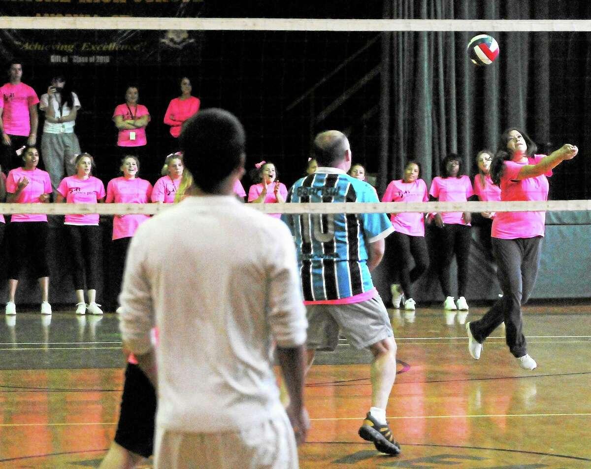 Allison Kinard, an Emmett O'Brien Technical High School social studies teacher and cheerleading coach, volleys during the Emmett O'Brien Goes Pink Day volleyball game Friday.