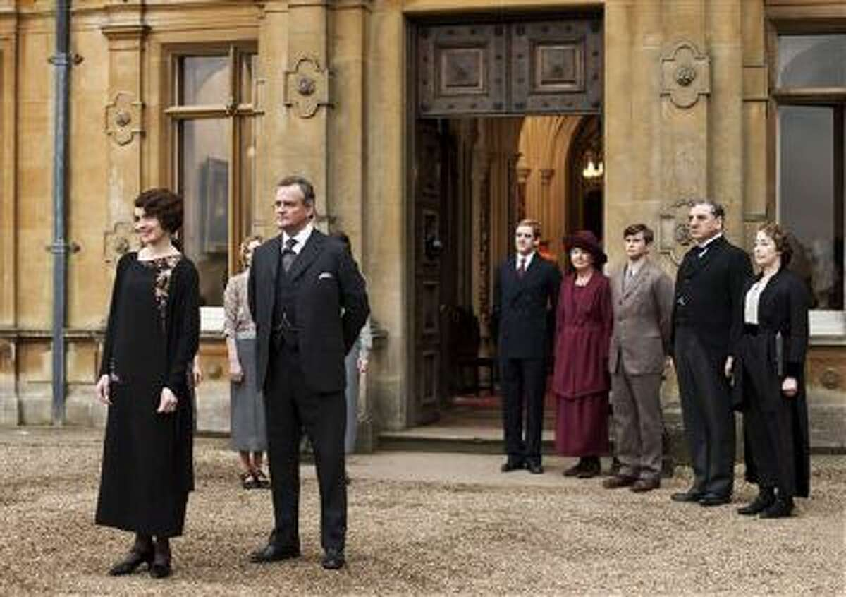 """This undated publicity photo provided by PBS shows, from left, Elizabeth McGovern as Lady Grantham, Hugh Bonneville as Lord Grantham, Dan Stevens as Matthew Crawley, Penelope Wilton as Isobel Crawley, Allen Leech as Tom Branson, Jim Carter as Mr. Carson, and Phyllis Logan as Mrs. Hughes, from the TV series, """"Downton Abbey."""""""